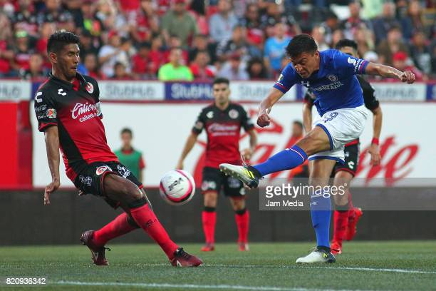 Juan Valenzuela of Tijuana and Felipe Mora of Cruz Azul compete for the ball during the 1st round match between Tijuana and Cruz Azul as part of the...