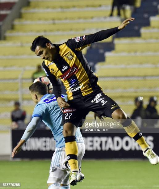 Juan Valverde of Bolivia's The Strongest vies for the ball with Gabriel Costa Heredia of Sporting Cristal of Peru during their Copa Libertadores...