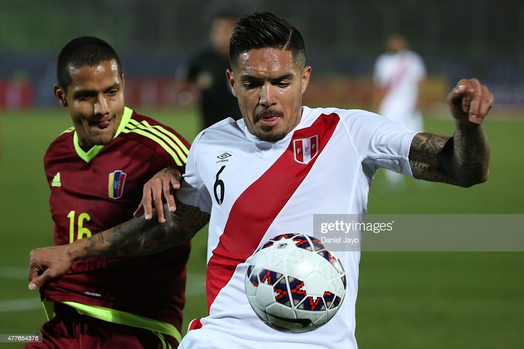 <a gi-track='captionPersonalityLinkClicked' href=/galleries/search?phrase=Juan+Vargas+-+Soccer+Player&family=editorial&specificpeople=4167791 ng-click='$event.stopPropagation()'>Juan Vargas</a> of Peru fights for the ball with Roberto Rosales of Venezuela during the 2015 Copa America Chile Group C match between Peru and Venezuela at Elías Figueroa Brander Stadium on June 18, 2015 in Valparaiso, Chile.