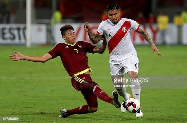 Juan Vargas of Peru struggles for the ball with Adalberto Penaranda of Venezuela during a match between Peru and Venezuela as part of FIFA 2018 World...