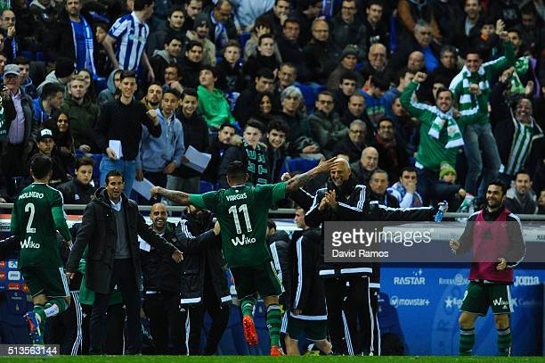 Juan Vargas of Real Betis Balompie celebrates with his team mates after scoring his team's third goal the La Liga match between Real CD Espanyol and...