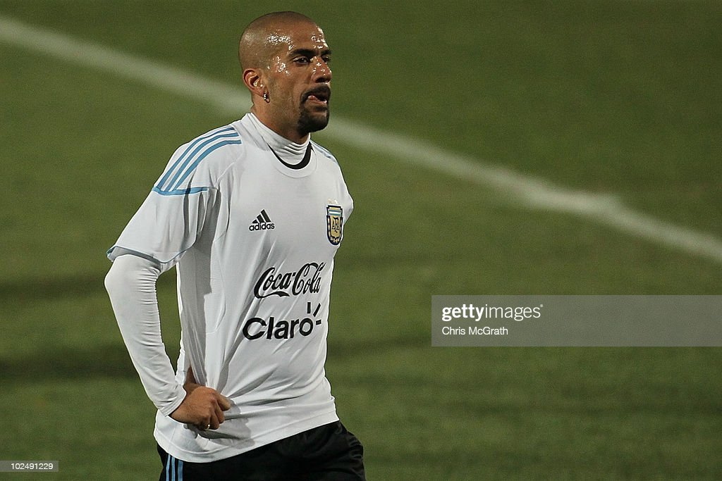 Juan Veron of Argentina's national football team walks off the pitch after a team training session on June 23, 2010 in Pretoria, South Africa.