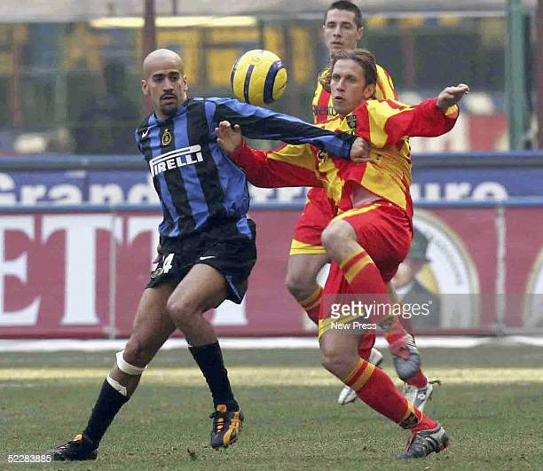 Juan Veron of Inter is challenged by Sam Della Bona of Leece during the Serie A match between Inter and Leece at the Stadio Giuseppe Meazza on March...
