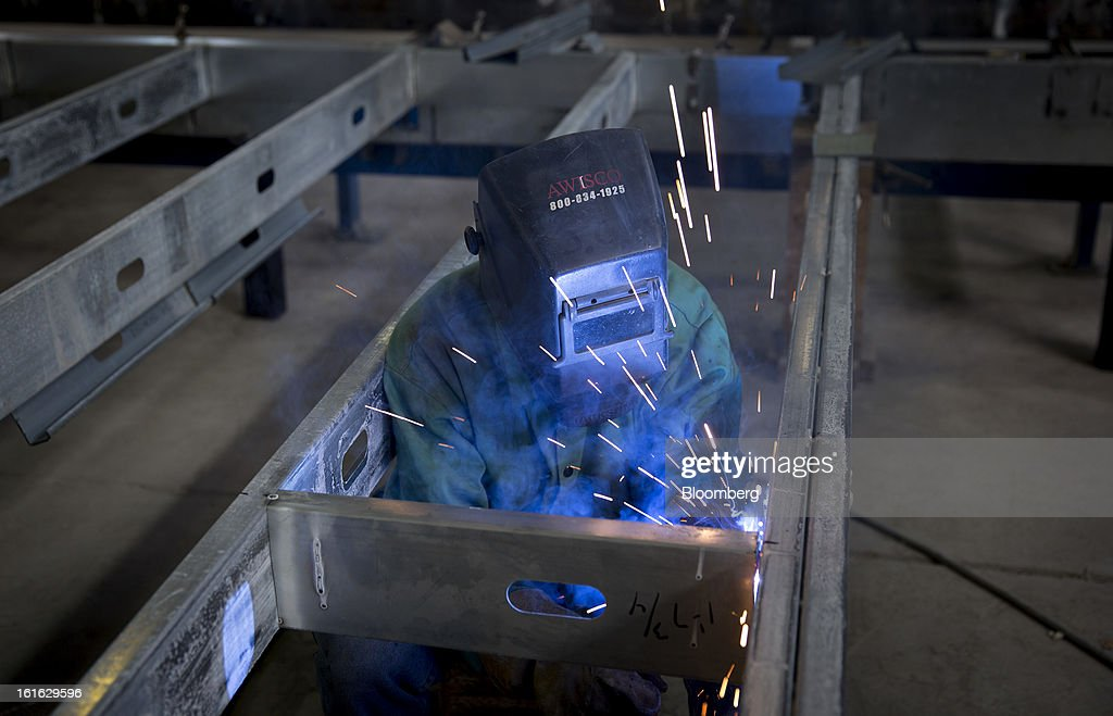 Juan Villegas, a Capsys Corp. employee, MIG welds a steel frame for a modular housing unit at the Brooklyn Navy Yard in the Brooklyn borough of New York, U.S., on Wednesday, Feb. 13, 2013. Capsys Corp., which specializes in prefabricated buildings, will be building micro-unit apartments in New York City. Photographer Scott Eells/Bloomberg via Getty Images