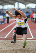 Juan Wang of China competes in the F44/46 Women's Long Jump during the Track and Field event of the Paralympic World Cup at the Manchester Regional...