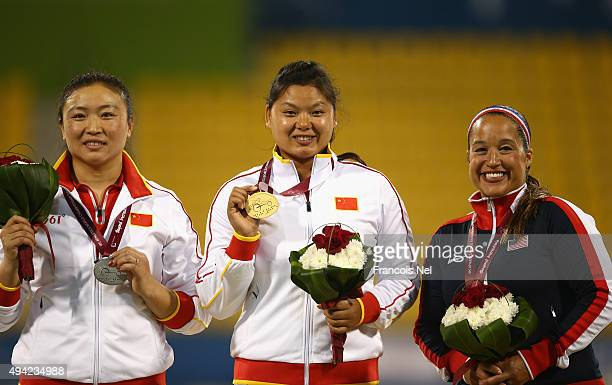 Juan Yao of China poses with her gold Yue Yang of China silver and Natalie Bieule of USA bronze after the women's discus F44 during the Evening...