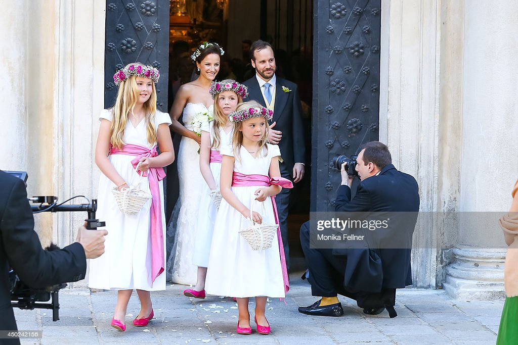 Juan Zorreguieta and Andrea Wolf, with flowers girls (L-R) Catharina-Amalia, Princess of Orange, Princess Alexia of the Netherlands, and Princess Ariane of the Netherlands, get married at Servite Church on June 07, 2014 in Vienna, Austria.