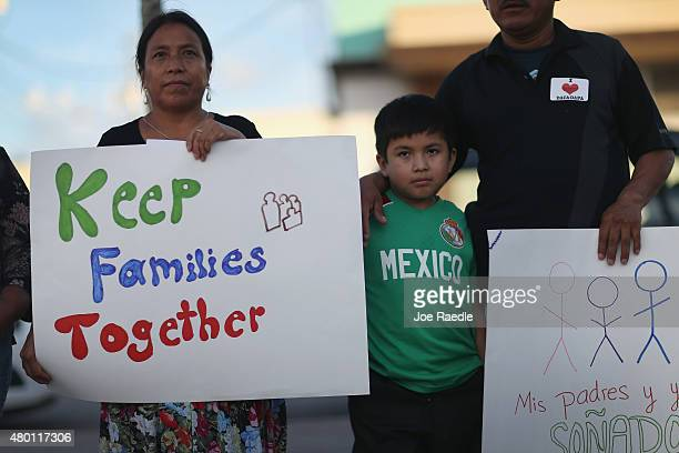 Juana de Leon originally from Guatemala and Rodrigo Hernandez stand with others as they show their support for the Obama administration's immigration...