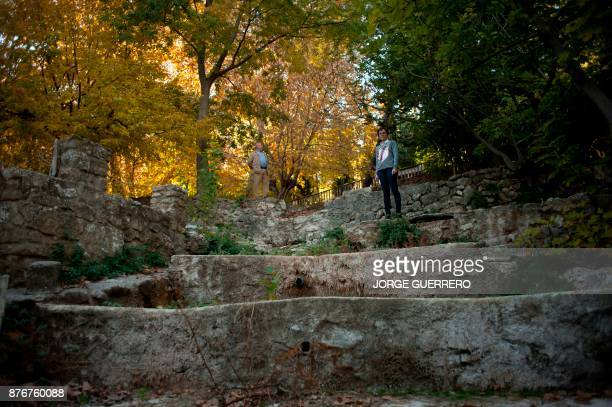 Juana Gasco and Nicolas Munoz pose by a dried up water source in droughtstricken Albanchez de Magina near Jaen on November 20 2017 Spain and Portugal...