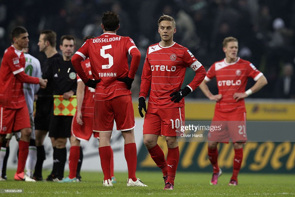 Juanan G Fernandez (L) and Ken Ilsoe (C) of Duesseldorf look dejected after the Bundesliga match between VfL Borussia Moenchengladbach v Fortuna Duesseldorf at Borussia Park Stadium on January 26, 2013 in Moenchengladbach, Germany.