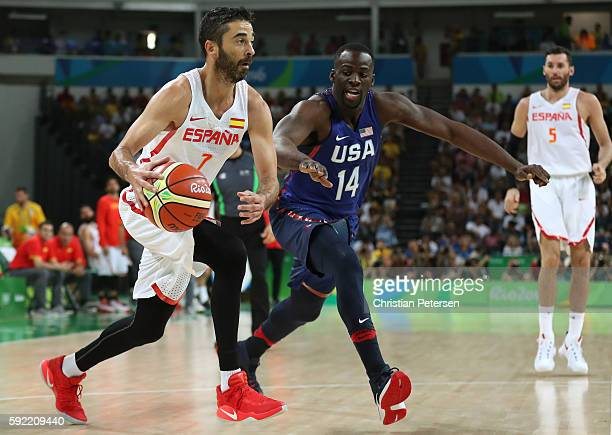 JuanCarlos Navarro of Spain handles the ball against Draymond Green of United States during the Men's Semifinal match on Day 14 of the Rio 2016...