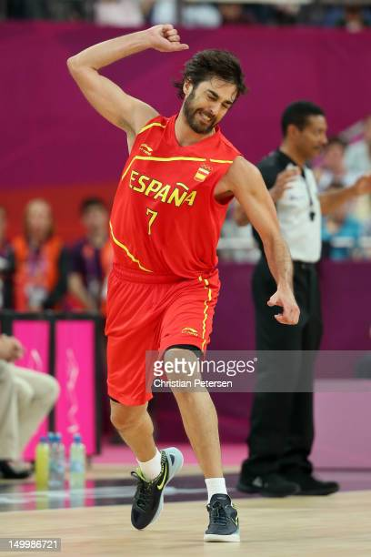 JuanCarlos Navarro of Spain reacts after making a threepoint basket in the first half against France during the Men's Basketball quaterfinal game on...