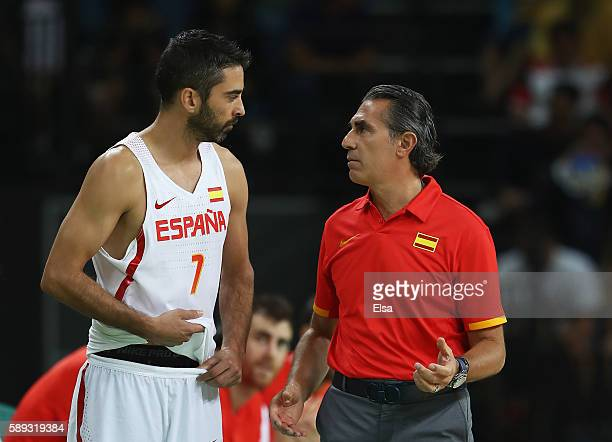 JuanCarlos Navarro of Spain talks to head coach Sergio Scariolo during the Men's Preliminary Round Group B between Spain and Lithuania on Day 8 of...