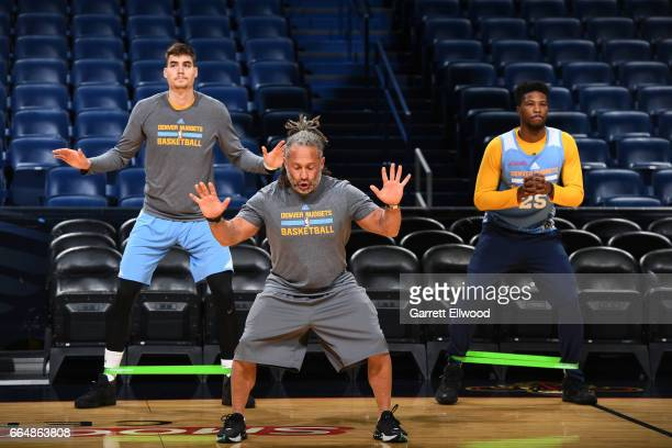 Juancho Hernangomez and Malik Beasley of the Denver Nuggets warm up before practice with strength and conditioning coach Steve Hess on April 4 2017...