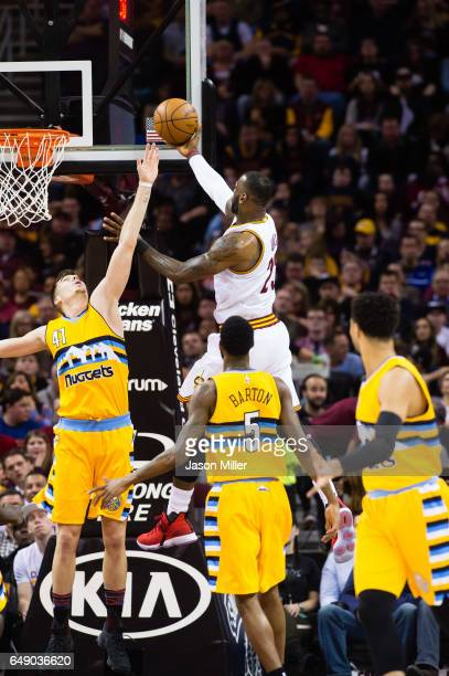 Juancho Hernangomez of the Denver Nuggets attempts to block LeBron James of the Cleveland Cavaliers during the first half at Quicken Loans Arena on...