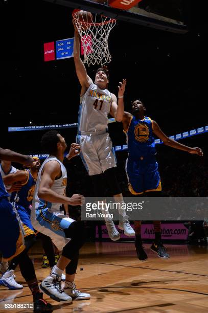 Juancho Hernangomez of the Denver Nuggets dunks the ball during the game against the Golden State Warriors on February 13 2017 at the Pepsi Center in...