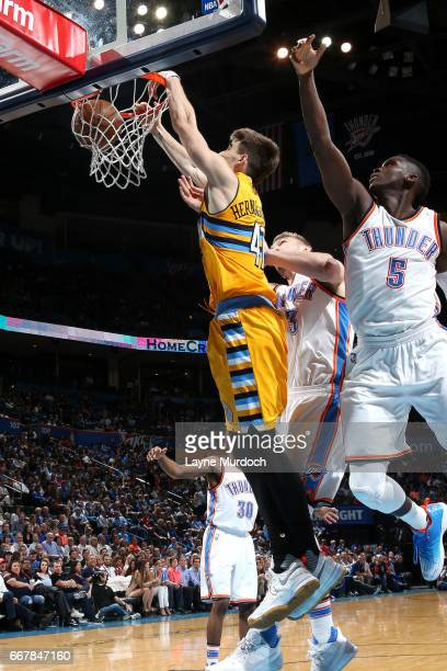 Juancho Hernangomez of the Denver Nuggets dunks the ball during the game against the Oklahoma City Thunder on April 12 2017 at Chesapeake Energy...