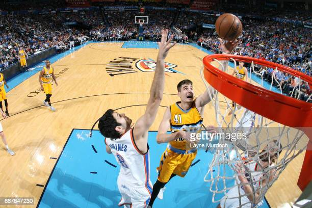 Juancho Hernangomez of the Denver Nuggets goes for a lay up during the game against the Oklahoma City Thunder on April 12 2017 at Chesapeake Energy...