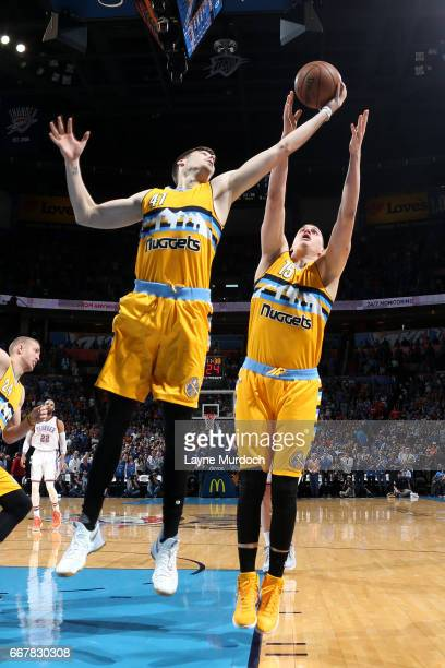 Juancho Hernangomez of the Denver Nuggets goes for the rebound during the game against the Oklahoma City Thunder on April 12 2017 at Chesapeake...