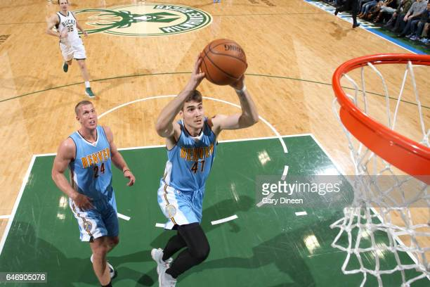Juancho Hernangomez of the Denver Nuggets goes to the basket against the Milwaukee Bucks on March 1 2017 at the BMO Harris Bradley Center in...