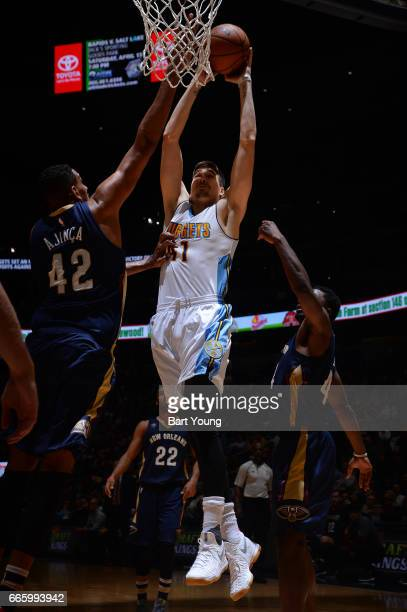 Juancho Hernangomez of the Denver Nuggets goes up for a dunk against the New Orleans Pelicans on April 7 2017 at the Pepsi Center in Denver Colorado...