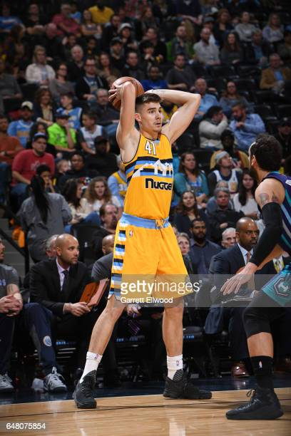 Juancho Hernangomez of the Denver Nuggets passes the ball against the Charlotte Hornets during the game on March 4 2017 at the Pepsi Center in Denver...