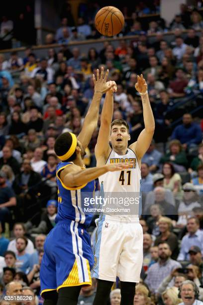 Juancho Hernangomez of the Denver Nuggets puts up a shot against James Michael McAdoo of the Golden State Warriors at the Pepsi Center on February 13...
