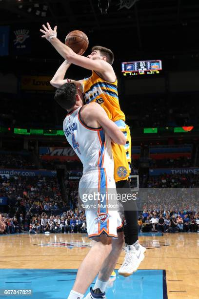 Juancho Hernangomez of the Denver Nuggets shoots the ball during the game against the Oklahoma City Thunder on April 12 2017 at Chesapeake Energy...