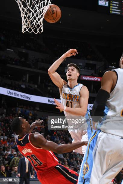 Juancho Hernangomez of the Denver Nuggets takes a shot against the Washington Wizards on March 8 2017 at the Pepsi Center in Denver Colorado NOTE TO...