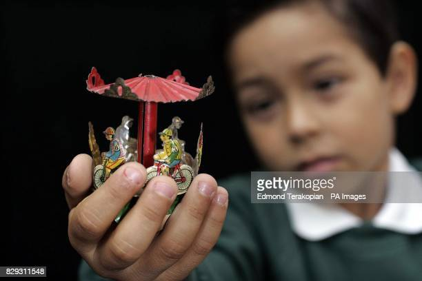 JuanDavid Malagon plays with a Meier Bicycle Carousel valued between 600 800 from the David Pressland Collection of fine penny toys and tinplate one...