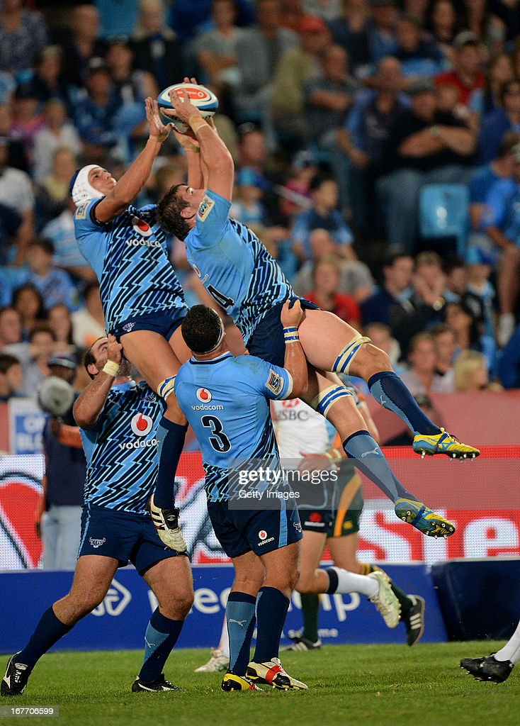 Juandre Kruger and Flip van der Merwe of the Bulls win ball from the kick-off during the Super Rugby match between Vodacom Bulls and Waratahs at Loftus Versveld on April 27, 2013 in Pretoria, South Africa.