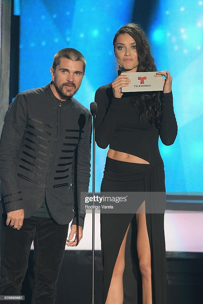 <a gi-track='captionPersonalityLinkClicked' href=/galleries/search?phrase=Juanes&family=editorial&specificpeople=202467 ng-click='$event.stopPropagation()'>Juanes</a> and <a gi-track='captionPersonalityLinkClicked' href=/galleries/search?phrase=Adriana+Lima&family=editorial&specificpeople=182444 ng-click='$event.stopPropagation()'>Adriana Lima</a> speak onstage at the Billboard Latin Music Awards at Bank United Center on April 28, 2016 in Miami, Florida.