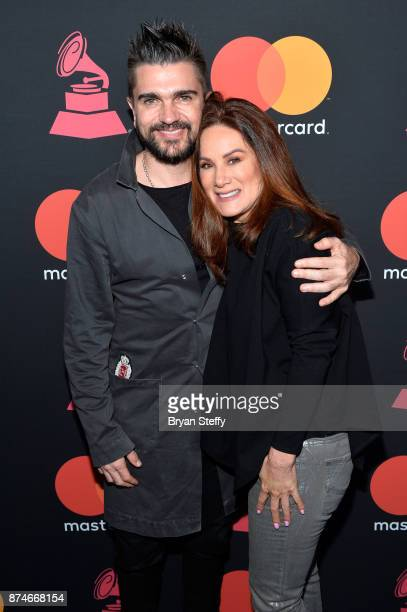 Juanes and Jessica Rodriguez Executive Vice President and Chief Marketing Officer at Univision attend the Mastercard Meet and Greet during the 18th...