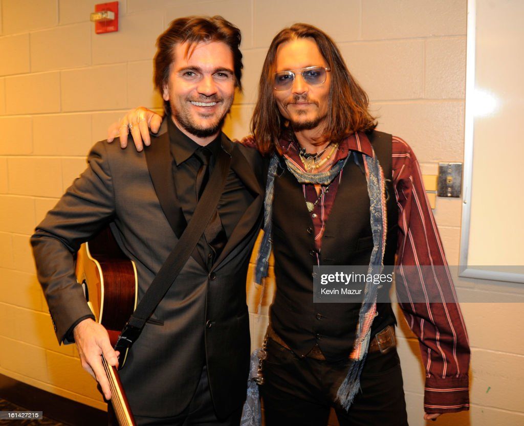 <a gi-track='captionPersonalityLinkClicked' href=/galleries/search?phrase=Juanes&family=editorial&specificpeople=202467 ng-click='$event.stopPropagation()'>Juanes</a> and <a gi-track='captionPersonalityLinkClicked' href=/galleries/search?phrase=Johnny+Depp&family=editorial&specificpeople=202150 ng-click='$event.stopPropagation()'>Johnny Depp</a> attend the 55th Annual GRAMMY Awards at STAPLES Center on February 10, 2013 in Los Angeles, California.