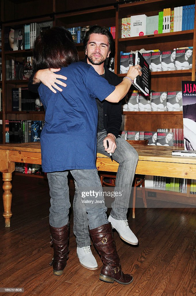 <a gi-track='captionPersonalityLinkClicked' href=/galleries/search?phrase=Juanes&family=editorial&specificpeople=202467 ng-click='$event.stopPropagation()'>Juanes</a> greets fans and signs copies of his book 'Chasing The Sun' at Books and Books on April 1, 2013 in Coral Gables, Florida.