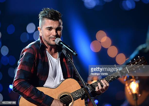 Juanes performs onstage during the Premios Juventud 2014 at The BankUnited Center on July 17 2014 in Coral Gables Florida