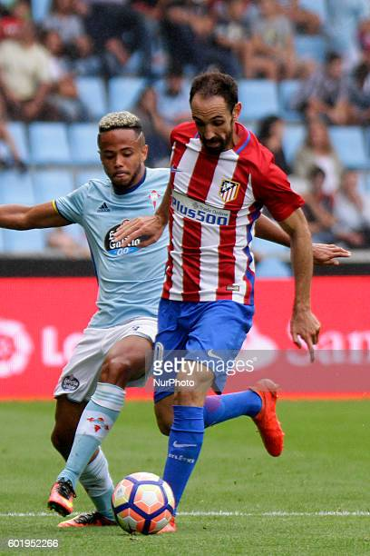 Juanfran and Theo Bongonda in action during the Spanish league football match Real Club Celta de Vigo vs Club Atlético de Madrid at estadio Municipal...