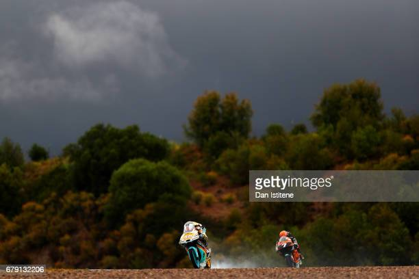 Juanfran Guevara of Spain and the RBA BOE Racing Team rides ahead of Adam Norrodin of Malaysia and the SIC Racing Team during free practice for Moto3...