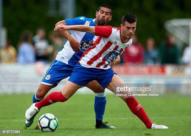 Juanfran Moreno of Deportivo de La Coruna competes for the ball with Cani of Cerceda during the preseason friendly match between Cerceda and...