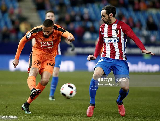Juanfran of Atletico Madrid and Bebe of Eibar vie for the ball during the King's Cup quarter final match between Atletico Madrid and Eibar at Vicente...