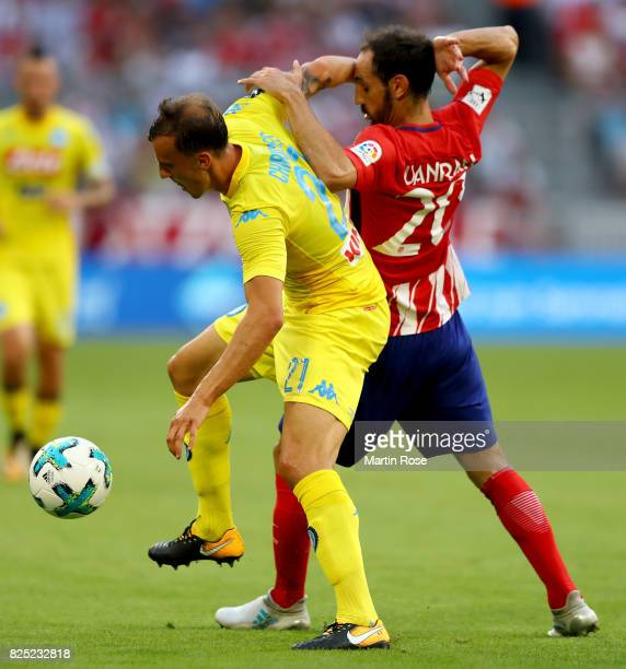 Juanfran of Atletico Madrid and Vlad Chiriches of Napoli battle for the ball during the Audi Cup 2017 match between Club Atletico de Madrid and SSC...