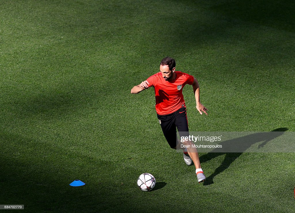 Juanfran of Atletico Madrid during an Atletico de Madrid training session on the eve of the UEFA Champions League Final against Real Madrid at Stadio Giuseppe Meazza on May 27, 2016 in Milan, Italy.