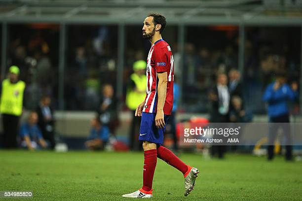 Juanfran of Atletico Madrid reacts after missing a penalty in a shootout during the UEFA Champions League final match between Real Madrid and Club...