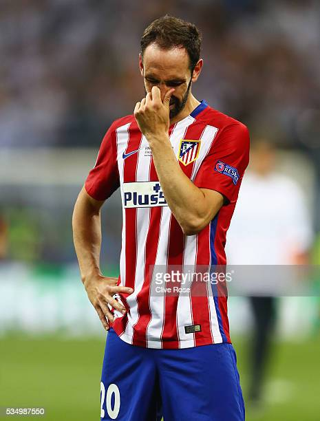 Juanfran of Atletico Madrid shows his dejection during the UEFA Champions League Final match between Real Madrid and Club Atletico de Madrid at...