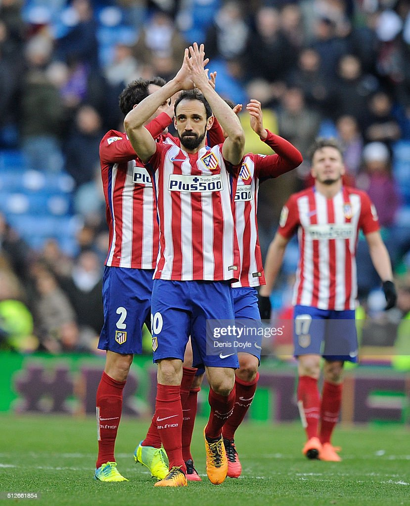 Juanfran of Club Atletico de Madrid celebrates with teammates after they beat Real 1-0 in the La Liga match between Real Madrid CF and Club Atletico de Madrid at Estadio Santiago Bernabeu on February 27, 2016 in Madrid, Spain.