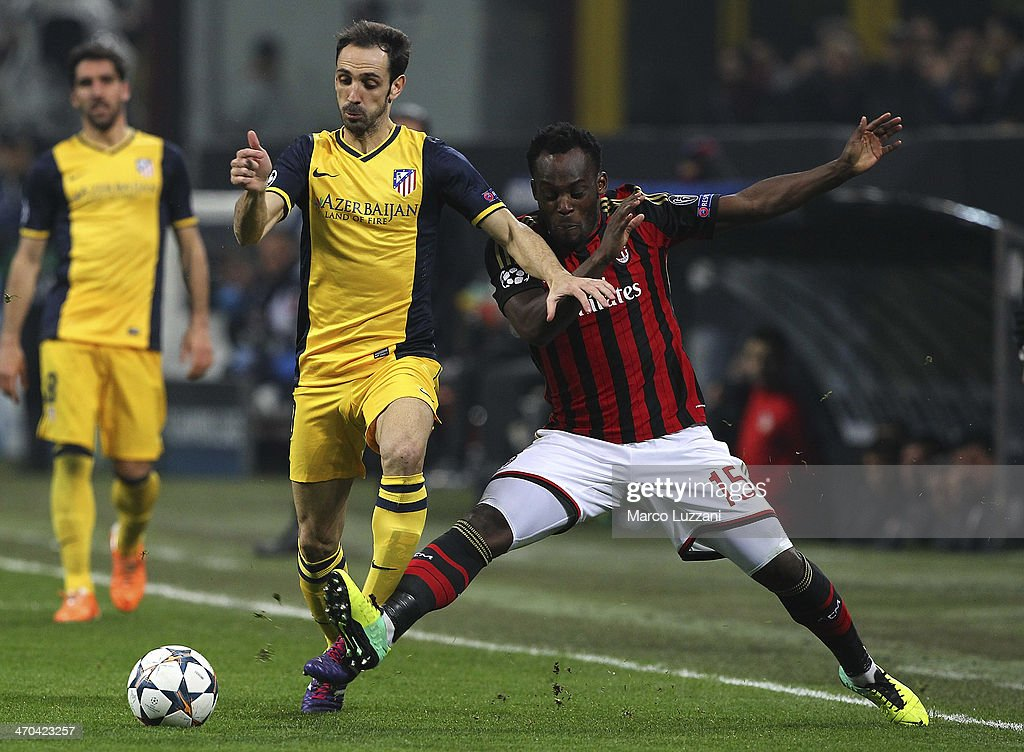 Juanfran of Club Atletico de Madrid competes for the ball with <a gi-track='captionPersonalityLinkClicked' href=/galleries/search?phrase=Michael+Essien&family=editorial&specificpeople=523500 ng-click='$event.stopPropagation()'>Michael Essien</a> of AC Milan during the UEFA Champions League Round of 16 match between AC Milan and Club Atletico de Madrid at Stadio Giuseppe Meazza on February 19, 2014 in Milan, Italy.