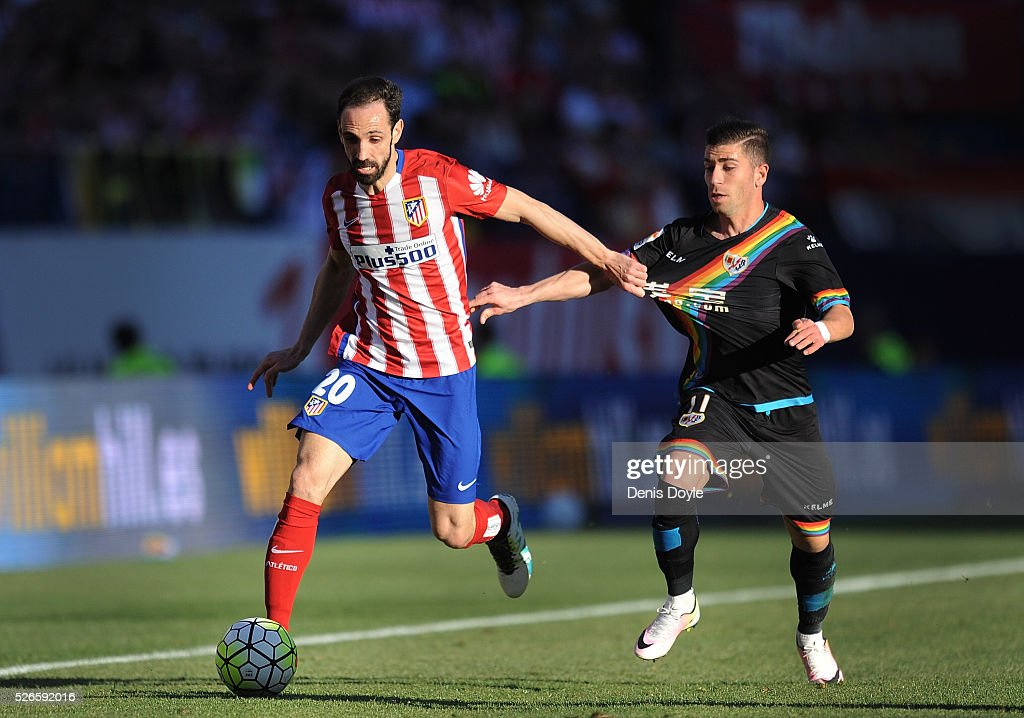 Juanfran of Club Atletico de Madrid ends off Adrian Embarba of Rayo Vallecano de Madrid during the La Liga match between Club Atletico de Madrid and Rayo Vallecano at Vicente Calderon Stadium on April 30, 2016 in Madrid, Spain.