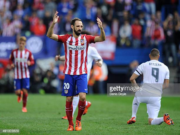 Juanfran of Club Atletico de Madrid reacts during the La Liga match between Club Atletico de Madrid and Real Madrid at Vicente Calderon Stadium on...