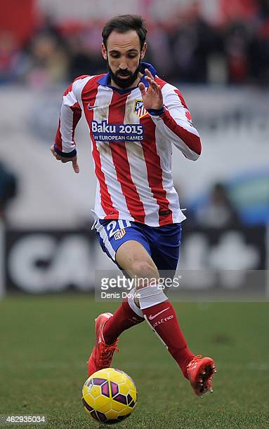 Juanfran of Club Atletico de Madrid warms up prior to the start of the La Liga match between Club Atletico de Madrid and Real Madrid at Vicente...