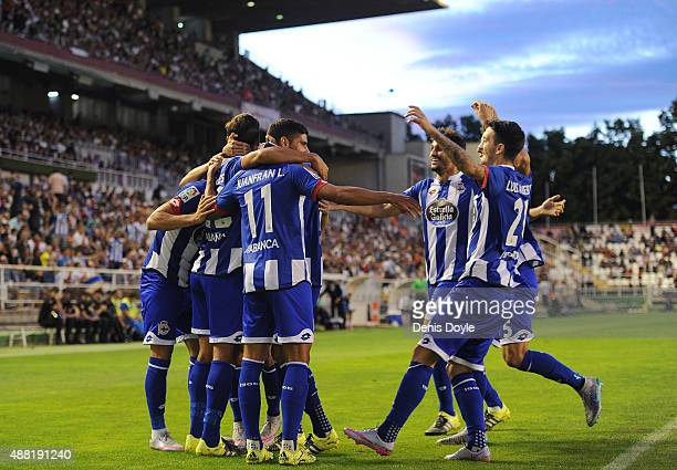 Juanfran of RC Deportivo la Coruna celebrates with teammates after Carlos Borges scored their opening goal during the La Liga match between Rayo...